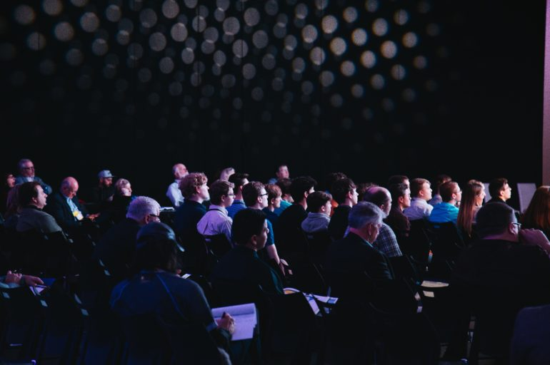 Crowd of people at a conference.