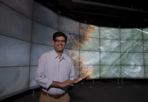 Dr Prakash holding a tablet with the SPARK technology